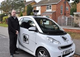 A proud council employee with CCTV car